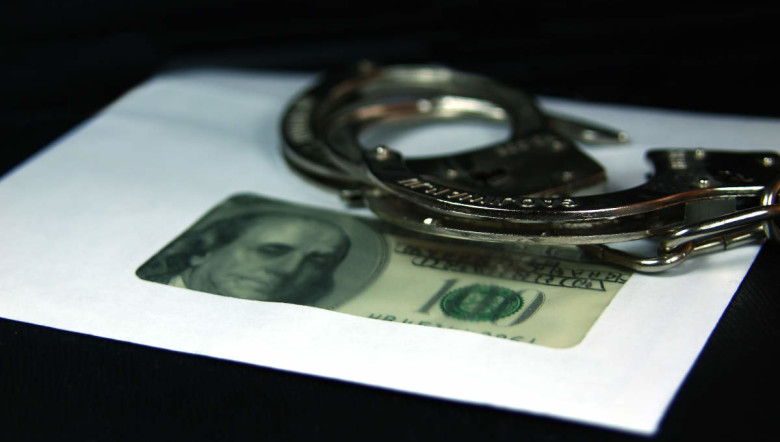 Illegal  salary.  Dollars,  envelope,  handcuffs.